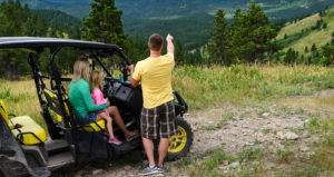 A family enjoys the summer view on an ATV ride