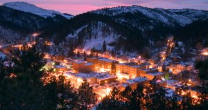 A snowy overview of Deadwood at sunset