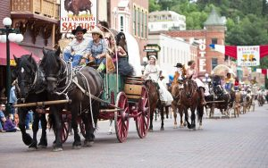 Traditional clothing is wore during the Days of 76 parade down the street in Historic Deadwood
