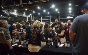 Festival goers enjoy wine and beer at the event