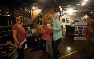 Forks, Corks & Kegs guests enjoying wine and more