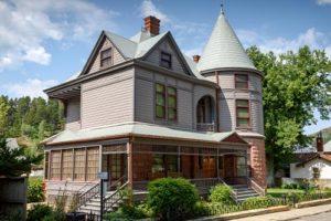 Historic Adams House on sunny day