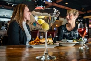 Women drinking cocktails at Deadwood Mt Grand