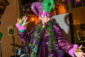 Woman dressed up for Mardi Gras event in Deadwood