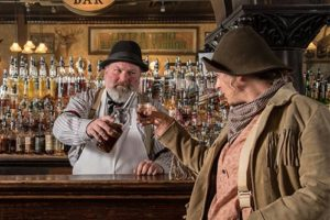 Man pouring a drink at the Saloon #10 in Deadwood