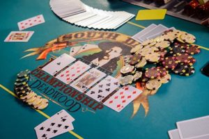 Poker table with chips and deck of cards at Silverado Franklin