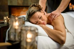 Woman getting a massage at a spa in Deadwood