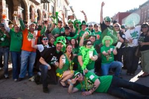 Group of adults in costume for St. Paddy's Day events in Deadwood