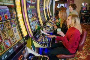 Women laughing while playing slots at The Lodge at Deadwood