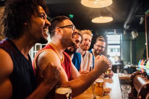 Guys cheering at a sports bar